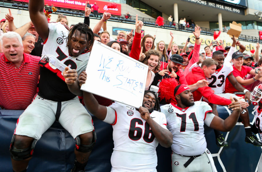 ATLANTA, GA - NOVEMBER 30: Isaiah Wilson #79, Andrew Thomas #71, and Solomon Kindley #66 of the Georgia Bulldogs celebrate following the Georgia Bulldogs win over the Georgia Tech Yellow Jackets 52-7 at Bobby Dodd Stadium on November 30, 2019 in Atlanta, Georgia. (Photo by Carmen Mandato/Getty Images)