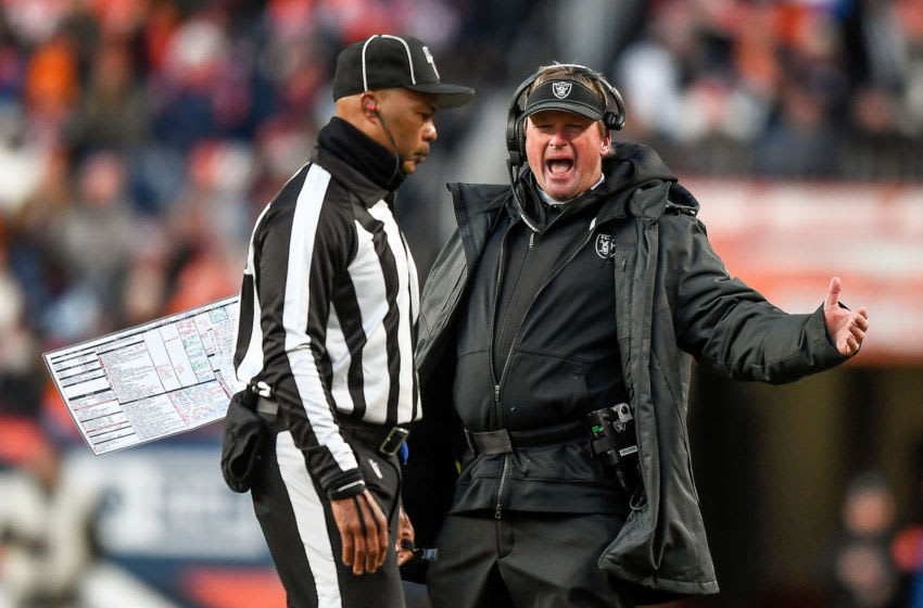 DENVER, CO - DECEMBER 29: Head coach Jon Gruden of the Oakland Raiders discusses a penalty with a referee during a game against the Denver Broncos at Empower Field at Mile High on December 29, 2019 in Denver, Colorado. (Photo by Dustin Bradford/Getty Images)