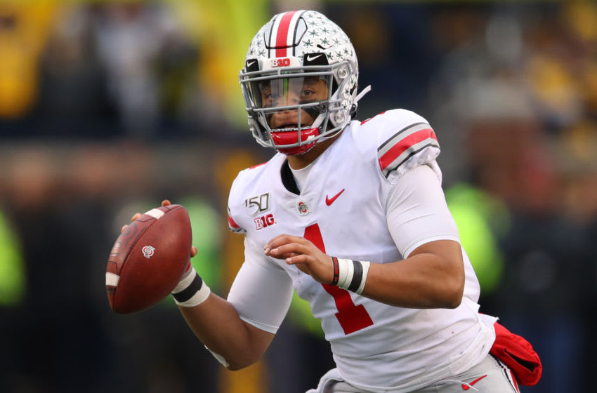 ANN ARBOR, MICHIGAN - NOVEMBER 30: Justin Fields #1 of the Ohio State Buckeyes throws a second half touchdown against the Michigan Wolverines at Michigan Stadium on November 30, 2019 in Ann Arbor, Michigan. Ohio State won the game 56-27. (Photo by Gregory Shamus/Getty Images)