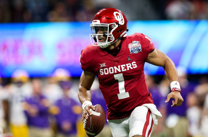 ATLANTA, GA - DECEMBER 28: Jalen Hurts #1 of the Oklahoma Sooners scrambles with the ball during the Chick-fil-A Peach Bowl against the LSU Tigers at Mercedes-Benz Stadium on December 28, 2019 in Atlanta, Georgia. (Photo by Carmen Mandato/Getty Images)