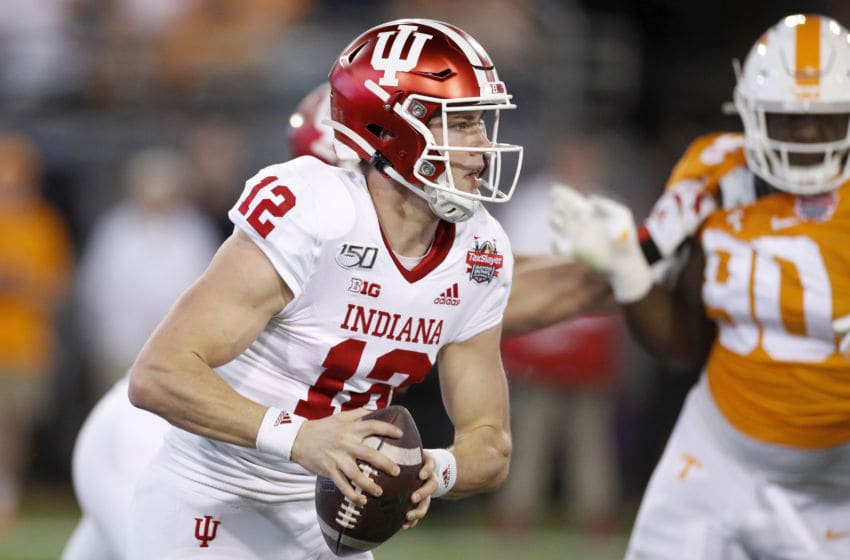 JACKSONVILLE, FL - JANUARY 02: Peyton Ramsey #12 of the Indiana Hoosiers head looks to pass the ball in the first half of the TaxSlayer Gator Bowl against the Tennessee Volunteers at TIAA Bank Field on January 2, 2020 in Jacksonville, Florida. (Photo by Joe Robbins/Getty Images)