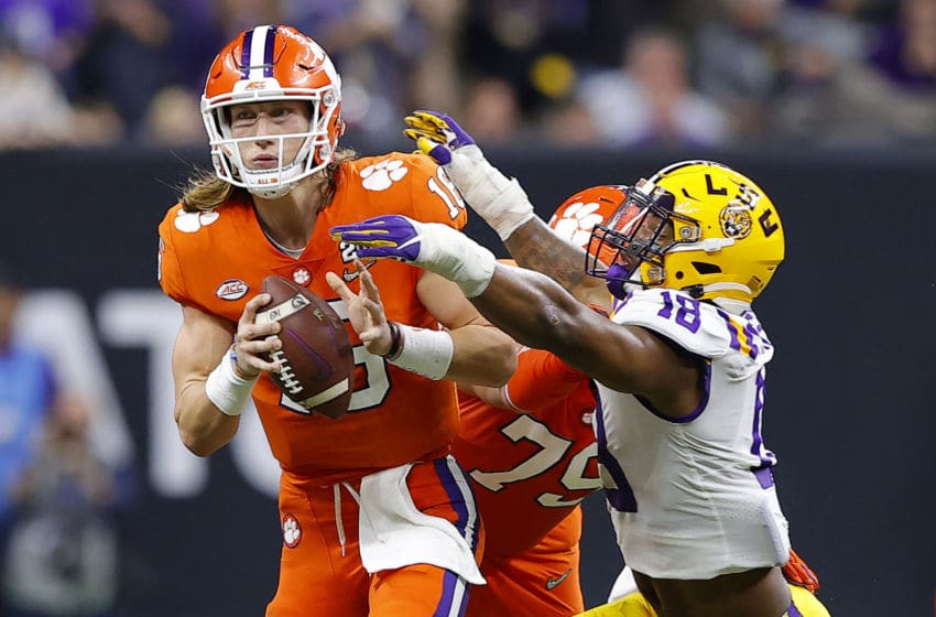 NEW ORLEANS, LOUISIANA - JANUARY 13: Trevor Lawrence #16 of the Clemson Tigers is sacked by K'Lavon Chaisson #18 of the LSU Tigers in the College Football Playoff National Championship game at Mercedes Benz Superdome on January 13, 2020 in New Orleans, Louisiana. (Photo by Kevin C. Cox/Getty Images)