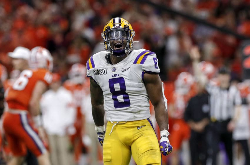 NEW ORLEANS, LA - JANUARY 13: Linebacker Patrick Queen #8 of the LSU Tigers celebrates after making a tackle during the College Football Playoff National Championship game against the Clemson Tigers at the Mercedes-Benz Superdome on January 13, 2020 in New Orleans, Louisiana. LSU defeated Clemson 42 to 25. (Photo by Don Juan Moore/Getty Images)