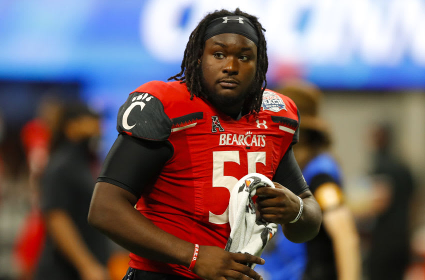 ATLANTA, GA - JANUARY 01: James Hudson #55 of the Cincinnati Bearcats recast at the conclusion of the Chick-fil-A Peach Bowl against the Georgia Bulldogs at Mercedes-Benz Stadium on January 1, 2021 in Atlanta, Georgia. (Photo by Todd Kirkland/Getty Images)