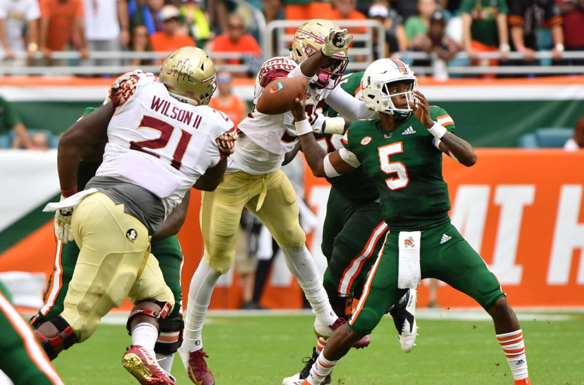 MIAMI, FL - OCTOBER 06: Brian Burns #99 of the Florida State Seminoles causes a fumble by N'Kosi Perry #5 of the Miami Hurricanes in the first half at Hard Rock Stadium on October 6, 2018 in Miami, Florida. (Photo by Mark Brown/Getty Images)