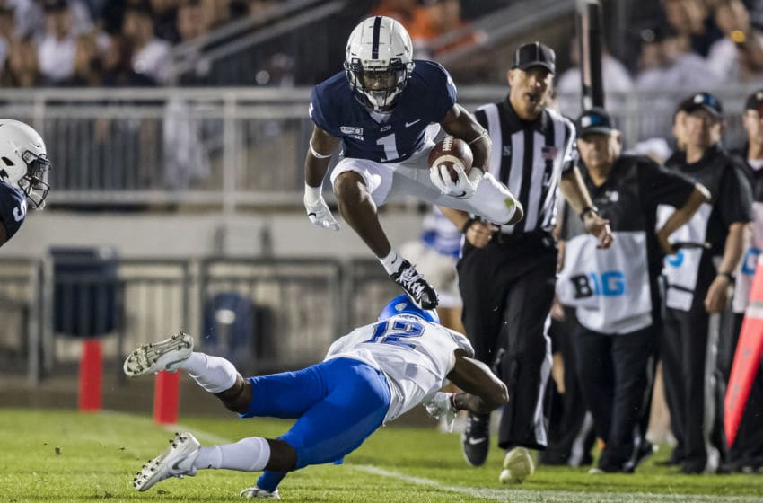 STATE COLLEGE, PA - SEPTEMBER 07: KJ Hamler #1 of the Penn State Nittany Lions hurdles Devon Russell #12 of the Buffalo Bulls during the first half at Beaver Stadium on September 07, 2019 in State College, Pennsylvania. (Photo by Scott Taetsch/Getty Images)