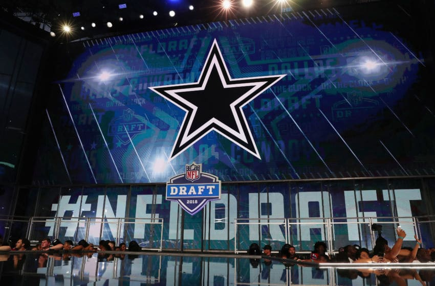 ARLINGTON, TX - APRIL 26: The Dallas Cowboys logo is seen on a video board during the first round of the 2018 NFL Draft at AT&T Stadium on April 26, 2018 in Arlington, Texas. (Photo by Tom Pennington/Getty Images)
