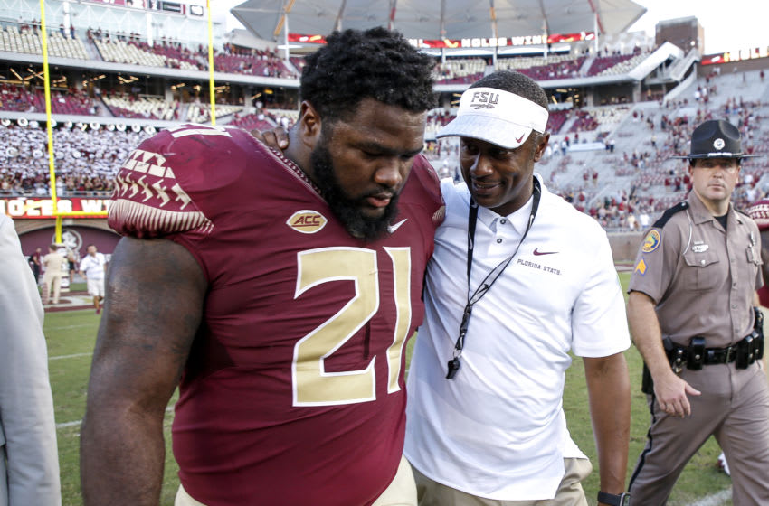 TALLAHASSEE, FL - SEPTEMBER 22: Head Coach Willie Taggart talks with Defensive Tackle Marvin Wilson #21 of the Florida State Seminoles after the game against the Northern Illinois Huskies at Doak Campbell Stadium on Bobby Bowden Field on September 22, 2018 in Tallahassee, Florida. The Seminoles defeated the Huskies 37 to 19. (Photo by Don Juan Moore/Getty Images)