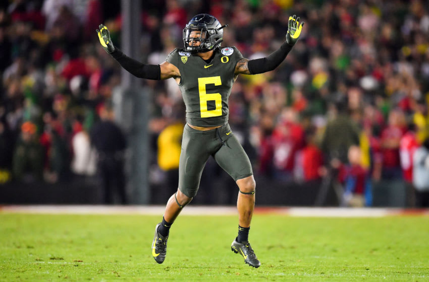 PASADENA, CALIFORNIA - JANUARY 01: Deommodore Lenoir #6 of the Oregon Ducks celebrates a big defensive stand during the fourth quarter of the game against the Wisconsin Badgers at the Rose Bowl on January 01, 2020 in Pasadena, California. The Oregon Ducks topped the Wisconsin Badgers, 28-27. (Photo by Alika Jenner/Getty Images)