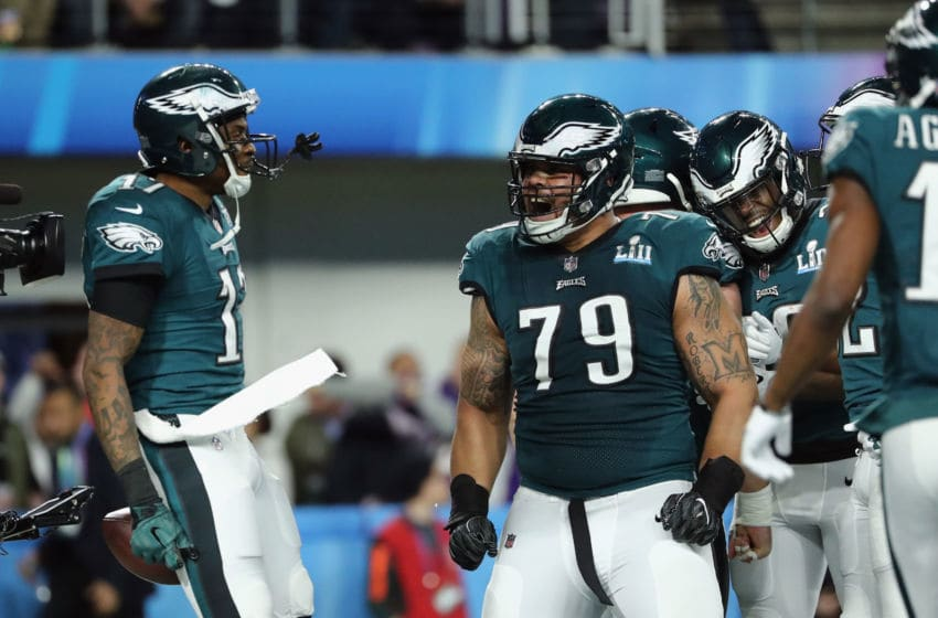 MINNEAPOLIS, MN - FEBRUARY 04: Brandon Brooks #79 of the Philadelphia Eagles and teammate Alshon Jeffery #17 celebrates a 34-yard touchdown pass in the first quarter of Super Bowl LII at U.S. Bank Stadium on February 4, 2018 in Minneapolis, Minnesota. (Photo by Elsa/Getty Images)