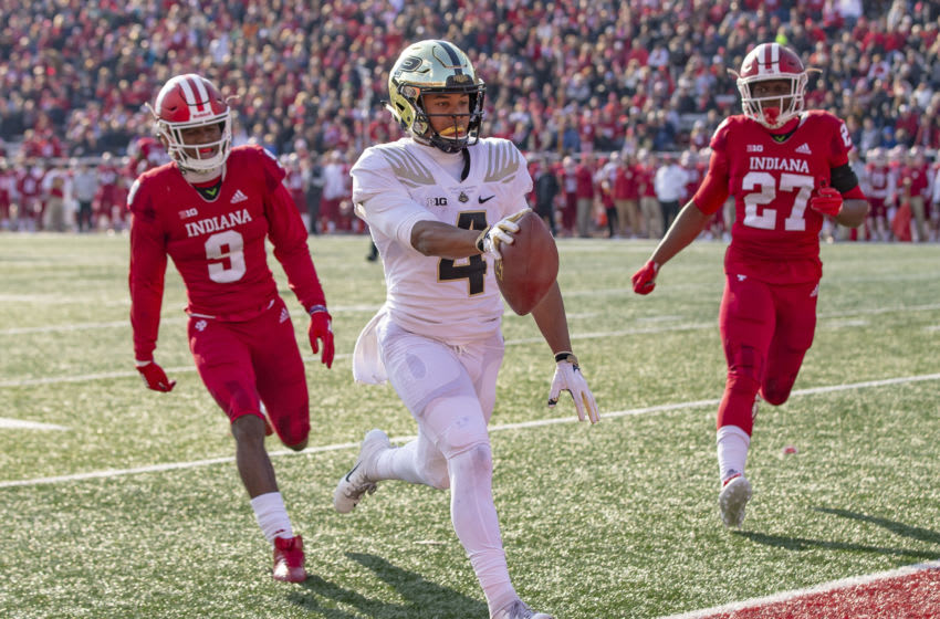 BLOOMINGTON, IN - NOVEMBER 24: Rondale Moore #4 of the Purdue Boilermakers runs the ball into the end zone during the game against the Indiana Hoosiers at Memorial Stadium on November 24, 2018 in Bloomington, Indiana. (Photo by Michael Hickey/Getty Images)