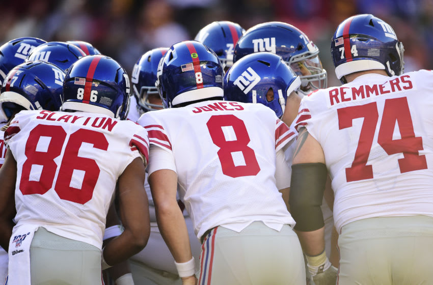 LANDOVER, MD - DECEMBER 22: Daniel Jones #8 of the New York Giants huddles with his teammates before a play against the Washington Redskins in the first half at FedExField on December 22, 2019 in Landover, Maryland. (Photo by Patrick McDermott/Getty Images)