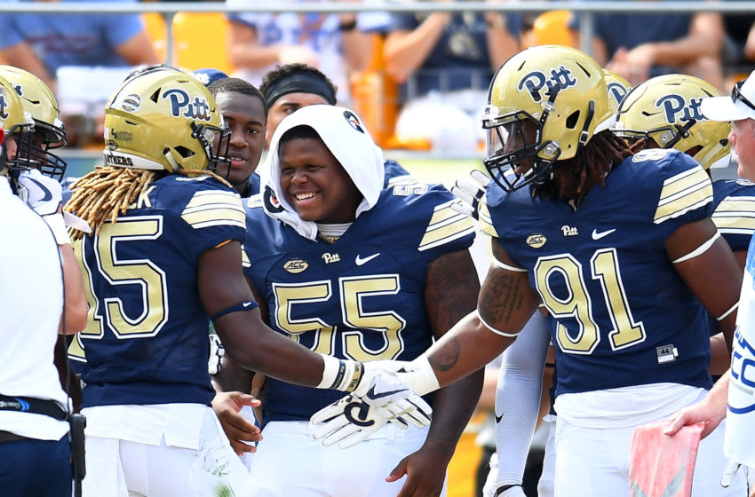 PITTSBURGH, PA - SEPTEMBER 16: Jason Pinnock #15 celebrates with Jaylen Twyman #55 and Patrick Jones II #91 of the Pittsburgh Panthers after his touchdown during the third quarter against the Oklahoma State Cowboys at Heinz Field on September 16, 2017 in Pittsburgh, Pennsylvania. (Photo by Joe Sargent/Getty Images)