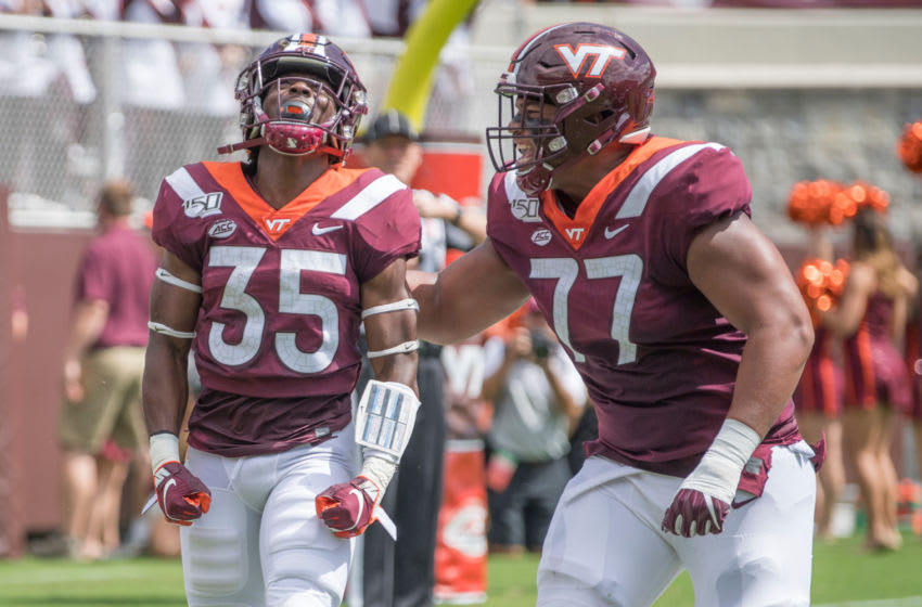 Sep 7, 2019; Blacksburg, VA, USA; Virginia Tech Hokies running back Keshawn King 935) celebrates his first touch down with Christian Darrisaw (77) in the first period against the Old Dominion Monarchs at Lane Stadium. Mandatory Credit: Lee Luther Jr.-USA TODAY Sports