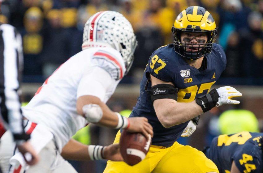 Michigan defensive lineman Aidan Hutchinson pursues on defense against Ohio State, Saturday, Nov. 30, 2019. Aidan Hutchinson