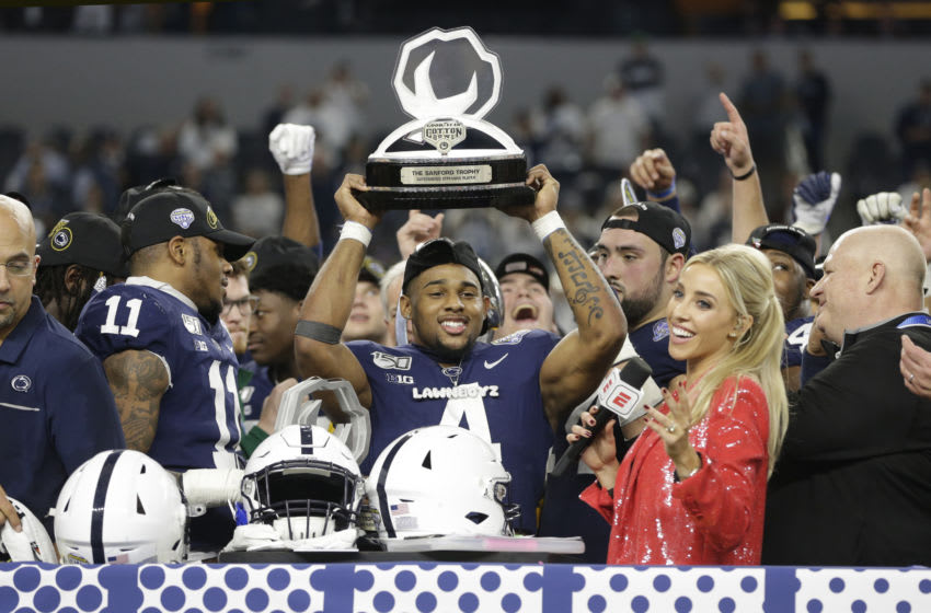 Dec 28, 2019; Arlington, Texas, USA; Penn State Nittany Lions running back Journey Brown (4) holds up the most outstanding offensive player trophy after the game against the Memphis Tigers at AT&T Stadium. Mandatory Credit: Tim Heitman-USA TODAY Sports