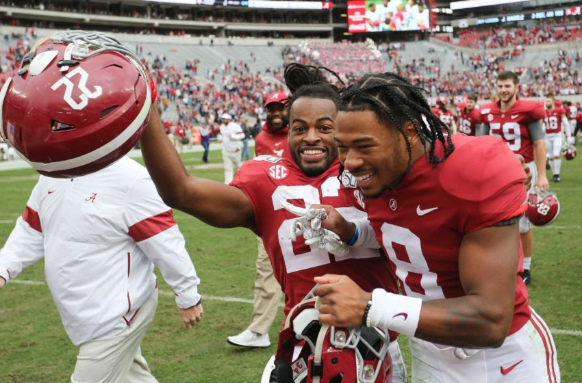 Alabama running back Najee Harris (22) and Alabama wide receiver John Metchie (8) have a good time as they leave the field following Alabama's 66-3 win over Western Carolina Saturday, Nov. 23, 2019, in Bryant-Denny Stadium. [Staff Photo/Gary Cosby Jr.] Alabama Vs Western Carolina