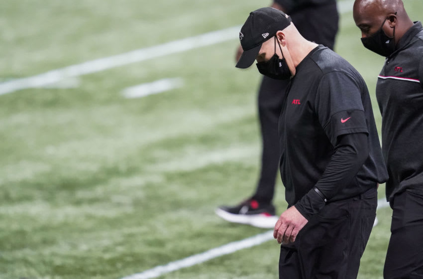 Oct 11, 2020; Atlanta, Georgia, USA; Atlanta Falcons head coach Dan Quinn walks off the field after the Falcons were defeated by the Carolina Panthers at Mercedes-Benz Stadium. Mandatory Credit: Dale Zanine-USA TODAY Sports