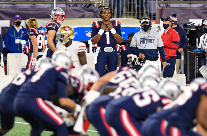 Oct 25, 2020; Foxborough, Massachusetts, USA; New England Patriots quarterback Cam Newton (1) watches from the sidelines as quarterback Jarrett Stidham (4) enters the game during the second half against the San Francisco 49ers at Gillette Stadium. Mandatory Credit: Brian Fluharty-USA TODAY Sports