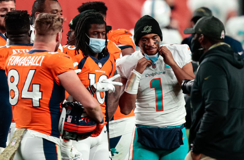 Nov 22, 2020; Denver, Colorado, USA; Denver Broncos wide receiver Jerry Jeudy (10) and Miami Dolphins quarterback Tua Tagovailoa (1) after the game at Empower Field at Mile High. Mandatory Credit: Isaiah J. Downing-USA TODAY Sports