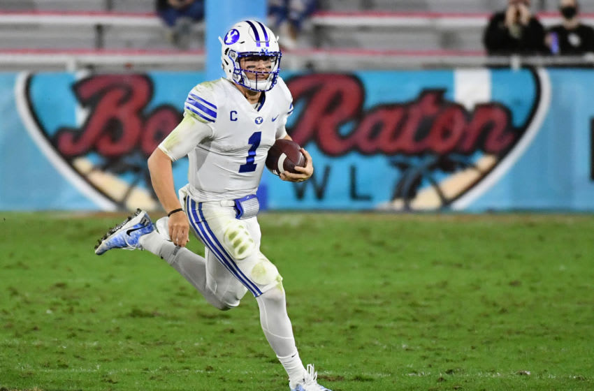 Dec 22, 2020; Boca Raton, Florida, USA; Brigham Young Cougars quarterback Zach Wilson (1) scrambles with the ball against the UCF Knights during the first half at FAU Stadium. Mandatory Credit: Jasen Vinlove-USA TODAY Sports