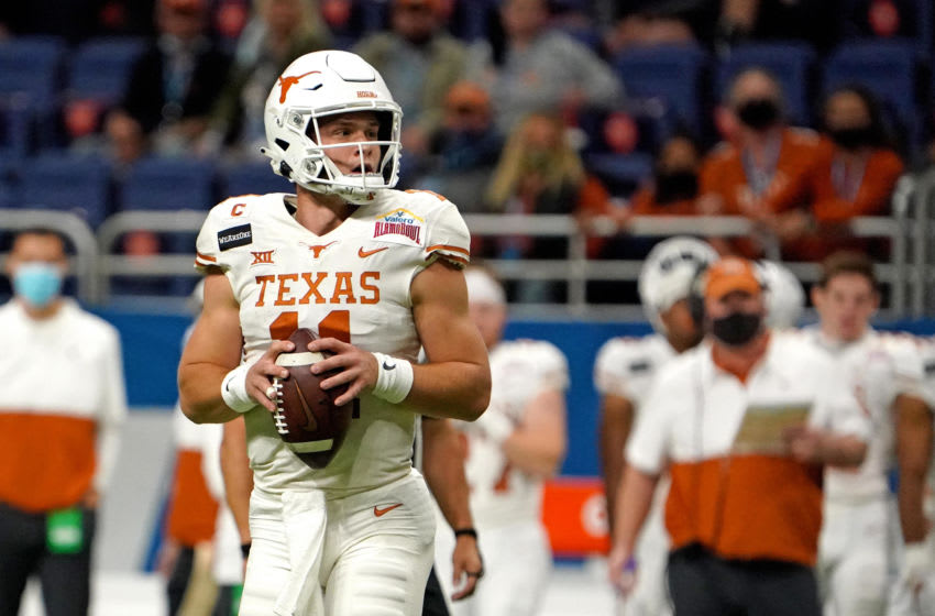 Dec 29, 2020; San Antonio, TX, USA; Texas Longhorns quarterback Sam Ehlinger (11) throws a pass against the Colorado Buffaloes during the first half at Alamodome. Mandatory Credit: Kirby Lee-USA TODAY Sports