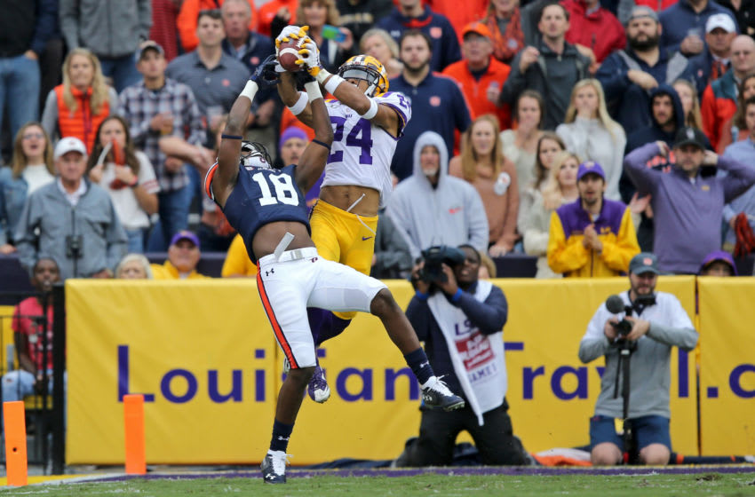 Oct 26, 2019; Baton Rouge, LA, USA; LSU Tigers cornerback Derek Stingley Jr. (24) intercepts a pass intended for Auburn Tigers wide receiver Seth Williams (18) in the second quarter at Tiger Stadium. Mandatory Credit: Chuck Cook-USA TODAY Sports