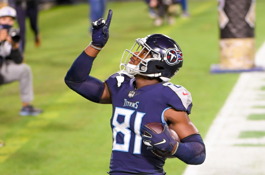 Nov 12, 2020; Nashville, Tennessee, USA; Tennessee Titans tight end Jonnu Smith (81) points to the sky after scoring a touchdown against the Indianapolis Colts during the first half at Nissan Stadium. Mandatory Credit: Steve Roberts-USA TODAY Sports