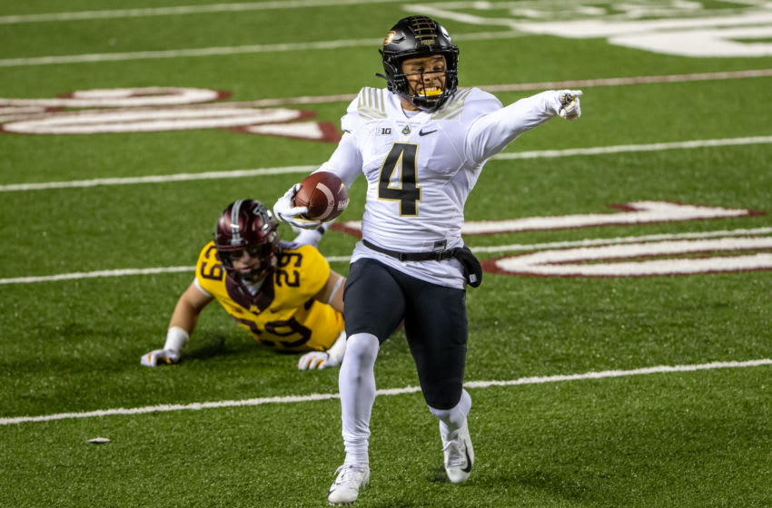 Nov 20, 2020; Minneapolis, Minnesota, USA; (Purdue Boilermakers wide receiver Rondale Moore (4) points to the end zone as he rushes for a touchdown in the first quarter against the Minnesota Golden Gophers at TCF Bank Stadium. Mandatory Credit: Jesse Johnson-USA TODAY Sports