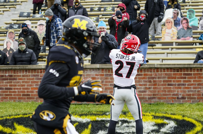 Dec 12, 2020; Columbia, Missouri, USA; Georgia Bulldogs defensive back Eric Stokes (27) celebrates after intercepting a pass against the Missouri Tigers during the first half at Faurot Field at Memorial Stadium. Mandatory Credit: Jay Biggerstaff-USA TODAY Sports