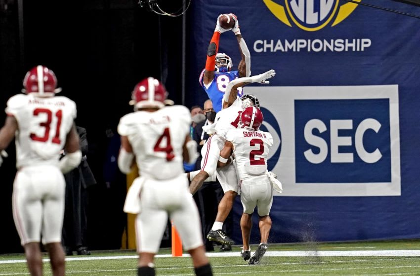 Dec 19, 2020; Atlanta, Georgia, USA; Florida Gators tight end Kyle Pitts (84) makes a touchdown catch against Alabama Crimson Tide defensive back Patrick Surtain II (2) during the fourth quarter in the SEC Championship at Mercedes-Benz Stadium. Mandatory Credit: Dale Zanine-USA TODAY Sports