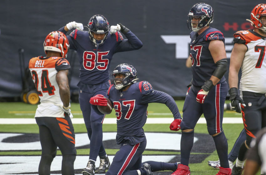 Dec 27, 2020; Houston, Texas, USA; Houston Texans tight end Darren Fells (87) celebrates after scoring a touchdown during the fourth quarter against the Cincinnati Bengals at NRG Stadium. Mandatory Credit: Troy Taormina-USA TODAY Sports