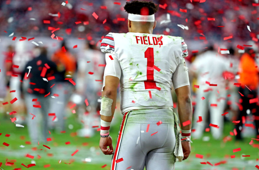 Jan 11, 2021; Miami Gardens, Florida, USA; Ohio State Buckeyes quarterback Justin Fields (1) walks off the field after losing to the Alabama Crimson Tide in the 2021 College Football Playoff National Championship Game. Mandatory Credit: Kim Klement-USA TODAY Sports