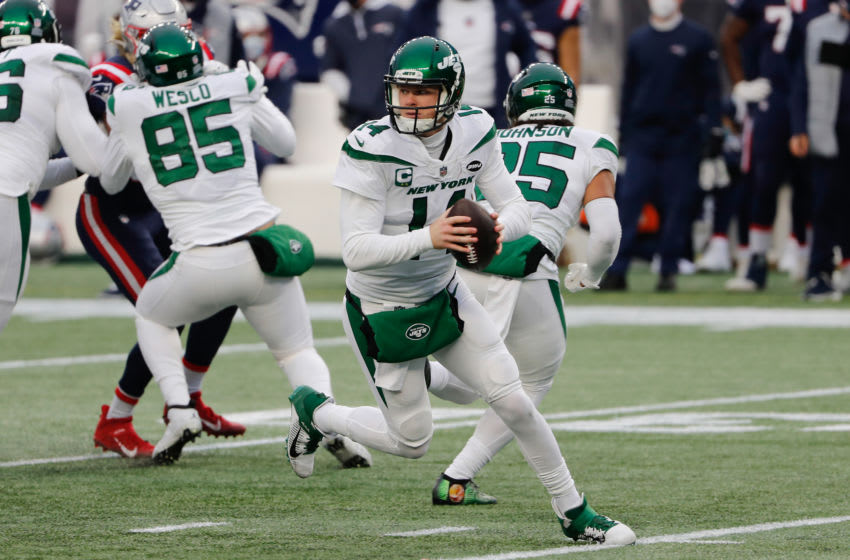 Jan 3, 2021; Foxborough, Massachusetts, USA; New York Jets quarterback Sam Darnold (14) against the New England Patriots during the first half at Gillette Stadium. Mandatory Credit: Winslow Townson-USA TODAY Sports