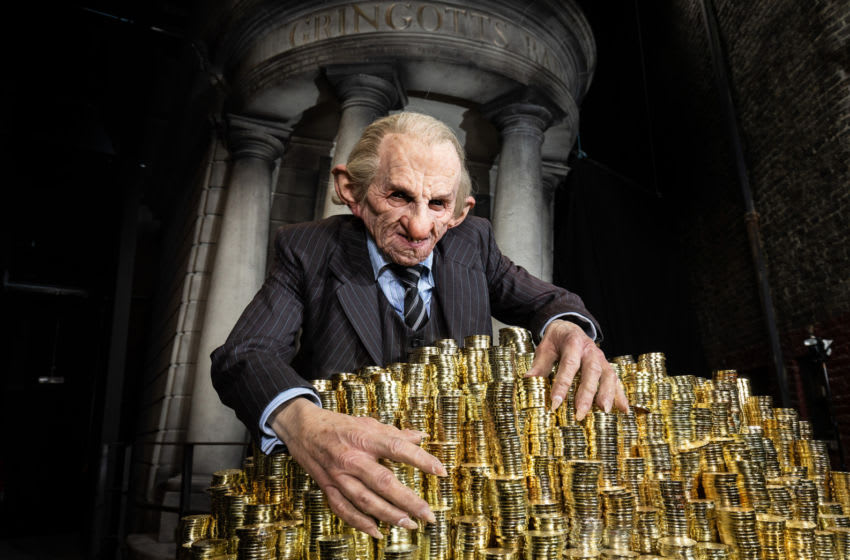 WATFORD, ENGLAND - UNSPECIFIED: A goblin prepares for the launch of the original Gringotts Wizarding Bank, the biggest expansion to date at Warner Bros. Studio Tour London in Watford, England. Officially opening on Saturday, 6th April, tickets are available from www.wbstudiotour.co.uk. (Photo by Tim Whitby/Getty Images)
