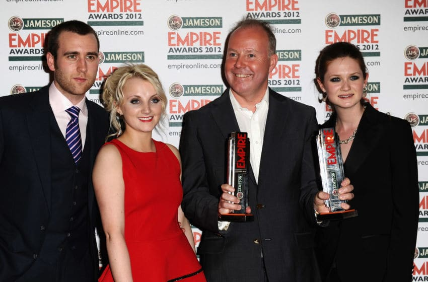 LONDON, ENGLAND - MARCH 25: (L to R) Matthew Lewis, Evanna Lynch, David Yates and Bonnie Wright accepts for Best Film winner Harry Potter And The Deatlhly Hallows: Part 2 during the 2012 Jameson Empire Awards at the Grosvenor House Hotel on March 25, 2012 in London, England. (Photo by Ian Gavan/Getty Images for Jameson)