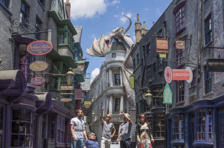 ORLANDO, FL - JUNE 18: In this handout provided by Universal Orlando Resort, Helena Bonham Carter (portrays Bellatrix Lestrange), Tom Felton (portrays Draco Malfoy), Matthew Lewis (portrays Neville Longbottom) and Warwick Davis (portrays Griphook) attend an exclusive preview of The Wizarding World of Harry Potter - Diagon Alley at Universal Orlando Resort on June 18, 2014 in Orlando, Florida. (Photo by Sheri Lowen/Universal Orlando Resort via Getty Images)