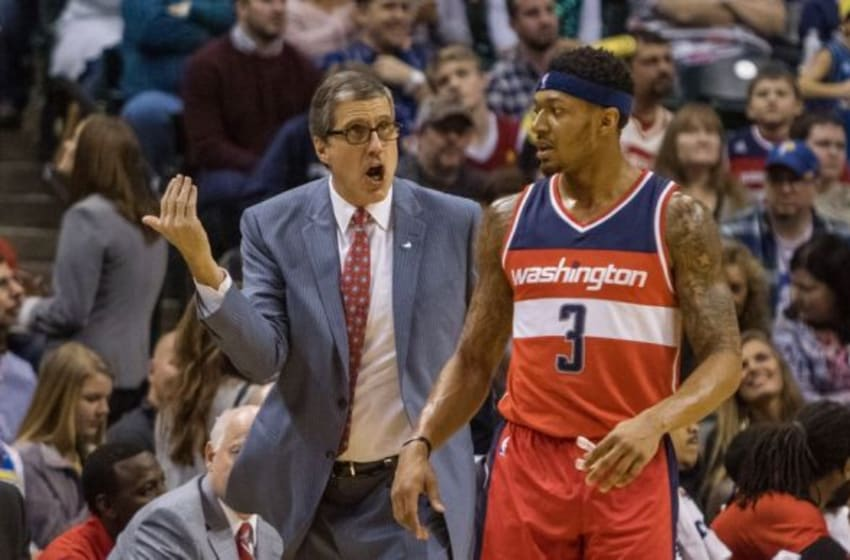 Jan 15, 2016; Indianapolis, IN, USA; Washington Wizards head coach Randy Wittman coaches guard Bradley Beal (3) on the sideline in the second half of the game against the Indiana Pacers at Bankers Life Fieldhouse. The Washington Wizards beat the Indiana Pacers 118-104. Mandatory Credit: Trevor Ruszkowski-USA TODAY Sports