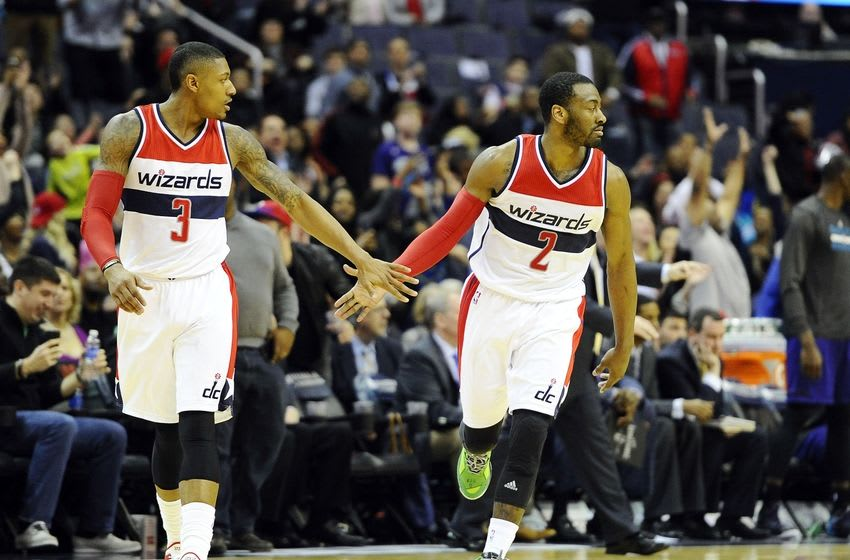 Mar 27, 2015; Washington, DC, USA; Washington Wizards guard John Wall (2) is congratulated by Washington Wizards guard Bradley Beal (3) after scoring a three pointer against the Charlotte Hornets during overtime at Verizon Center. The Wizards won in double overtime 110 - 107. Mandatory Credit: Brad Mills-USA TODAY Sports