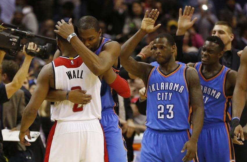 Jan 21, 2015; Washington, DC, USA; Oklahoma City Thunder forward Kevin Durant (35) hugs Washington Wizards guard John Wall (2) after their game at Verizon Center. The Thunder won 105-103 in overtime. Mandatory Credit: Geoff Burke-USA TODAY Sports