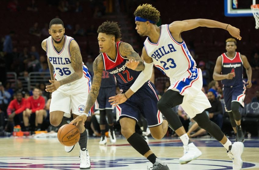 Oct 6, 2016; Philadelphia, PA, USA; Washington Wizards forward Kelly Oubre Jr. (12) dribbles the ball past Philadelphia 76ers forward James Webb III (23) during overtime at Wells Fargo Center. The Washington Wizards 125-119. Mandatory Credit: Bill Streicher-USA TODAY Sports