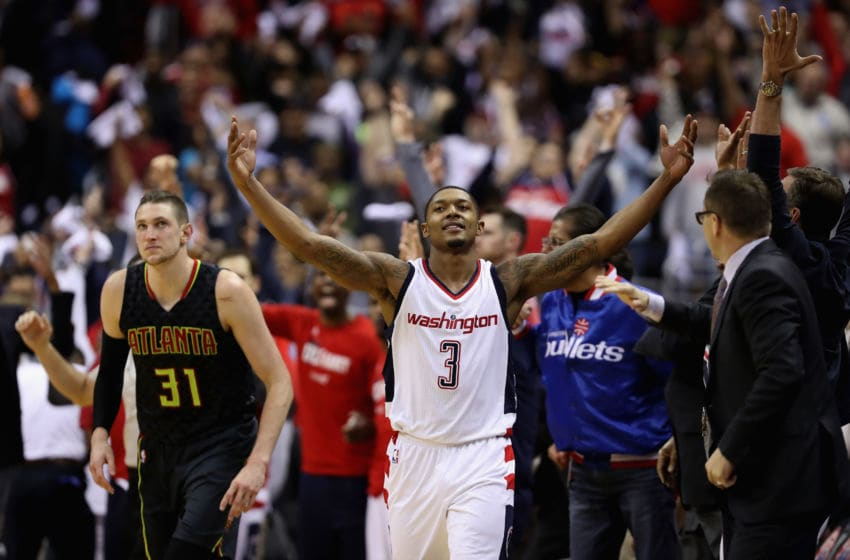 WASHINGTON, DC - APRIL 19: Bradley Beal #3 of the Washington Wizards celebrates in front of Mike Muscala #31 of the Atlanta Hawks after hitting a three pointer in the second half of the Wizards 109-101 win in Game Two of the Eastern Conference Quarterfinals during the 2017 NBA Playoffs at Verizon Center on April 19, 2017 in Washington, DC. (Photo by Rob Carr/Getty Images)