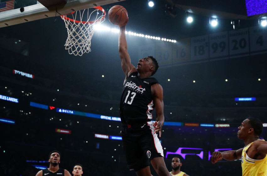 LOS ANGELES, CALIFORNIA - MARCH 26: Thomas Bryant #13 of the Washington Wizards dunks the ball against the Los Angeles Lakers during the first half at Staples Center on March 26, 2019 in Los Angeles, California. (Photo by Yong Teck Lim/Getty Images)