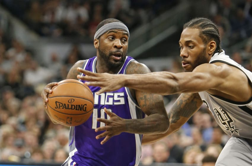 SAN ANTONIO,TX - MARCH 19: Ty Lawson #10 of the Sacramento Kings drives on Kawhi Leonard #2 of the San Antonio Spurs at AT&T Center on March 19, 2017 in San Antonio, Texas. NOTE TO USER: User expressly acknowledges and agrees that , by downloading and or using this photograph, User is consenting to the terms and conditions of the Getty Images License Agreement. (Photo by Ronald Cortes/Getty Images)