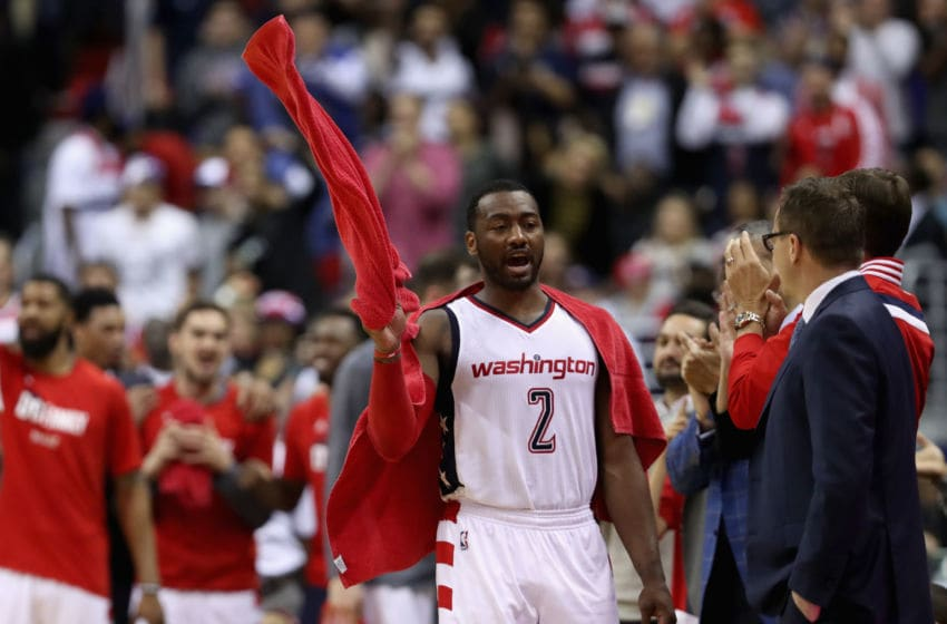 WASHINGTON, DC - APRIL 26: John Wall #2 of the Washington Wizards celebrates in the second half of their 103-99 win over the Atlanta Hawks in Game Five of the Eastern Conference Quarterfinals during the 2017 NBA Playoffs at at Verizon Center on April 26, 2017 in Washington, DC. (Photo by Rob Carr/Getty Images)