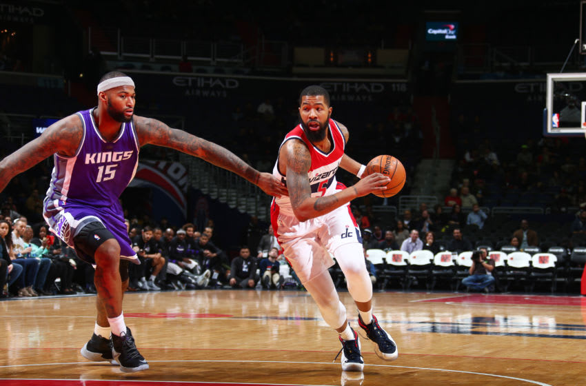 WASHINGTON, DC - NOVEMBER 28: Markieff Morris #5 of the Washington Wizards handles the ball against DeMarcus Cousins #15 of the Sacramento Kings on November 28, 2016 at Verizon Center in Washington, DC. NOTE TO USER: User expressly acknowledges and agrees that, by downloading and or using this Photograph, user is consenting to the terms and conditions of the Getty Images License Agreement. Mandatory Copyright Notice: Copyright 2016 NBAE (Photo by Ned Dishman/NBAE via Getty Images)