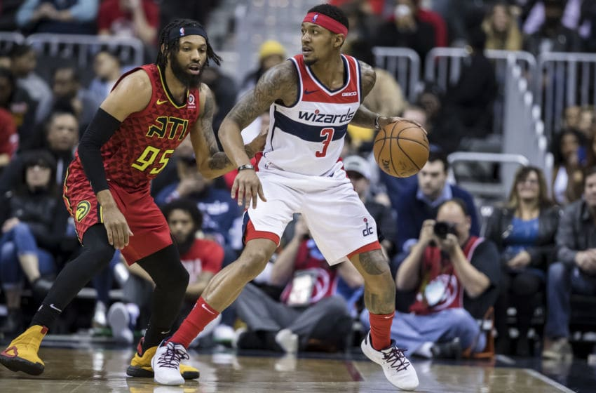 WASHINGTON, DC - FEBRUARY 4: Bradley Beal #3 of the Washington Wizards handles the ball against DeAndre' Bembry #95 of the Atlanta Hawks during the second half at Capital One Arena on February 4, 2019 in Washington, DC. NOTE TO USER: User expressly acknowledges and agrees that, by downloading and or using this photograph, User is consenting to the terms and conditions of the Getty Images License Agreement. (Photo by Scott Taetsch/Getty Images)