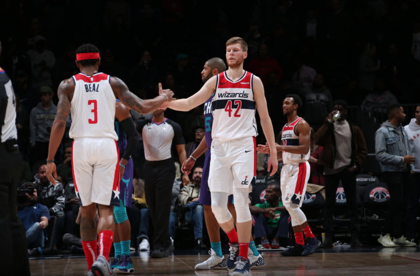 WASHINGTON, DC -  NOVEMBER 22: Bradley Beal #3 and Davis Bertans #42 of the Washington Wizards hi-five during a game against the Charlotte Hornets on November 22, 2019 at Capital One Arena in Washington, DC. NOTE TO USER: User expressly acknowledges and agrees that, by downloading and or using this Photograph, user is consenting to the terms and conditions of the Getty Images License Agreement. Mandatory Copyright Notice: Copyright 2019 NBAE (Photo by Ned Dishman/NBAE via Getty Images)