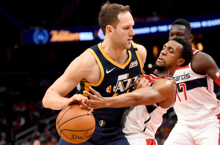 WASHINGTON, DC - JANUARY 12: Bojan Bogdanovic #44 of the Utah Jazz dribbles in front of Ish Smith #14 of the Washington Wizards during the second half at Capital One Arena on January 12, 2020 in Washington, DC. NOTE TO USER: User expressly acknowledges and agrees that, by downloading and or using this photograph, User is consenting to the terms and conditions of the Getty Images License Agreement. (Photo by Will Newton/Getty Images)