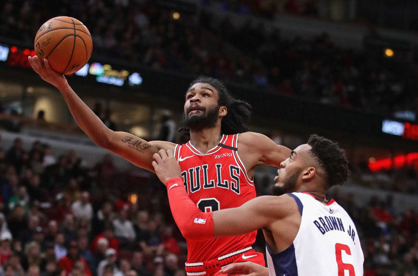 CHICAGO, ILLINOIS - JANUARY 15: Coby White #0 of the Chicago Bulls drives against Troy Brown Jr. #6 of the Washington Wizards and puts up a shot at the United Center on January 15, 2020 in Chicago, Illinois. NOTE TO USER: User expressly acknowledges and agrees that, by downloading and or using this photograph, User is consenting to the terms and conditions of the Getty Images License Agreement. (Photo by Jonathan Daniel/Getty Images)